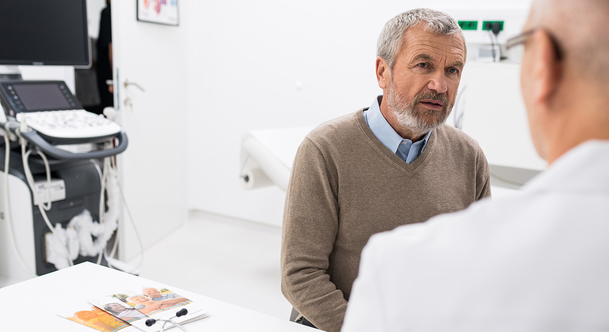 Male patient talking to male doctor_reduced_blog post